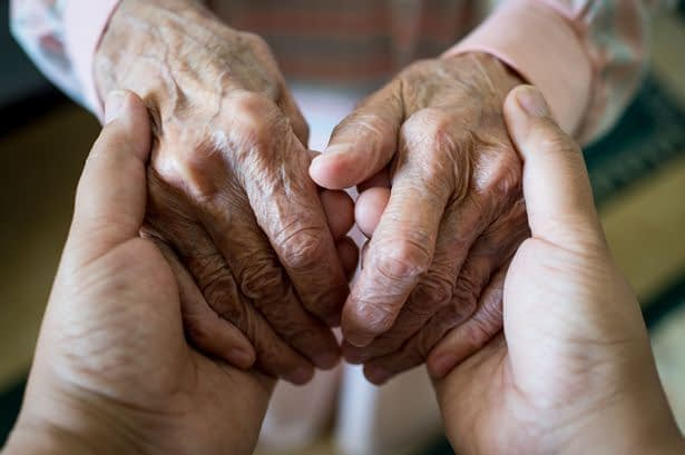 1_Young-woman-holding-elder-hands
